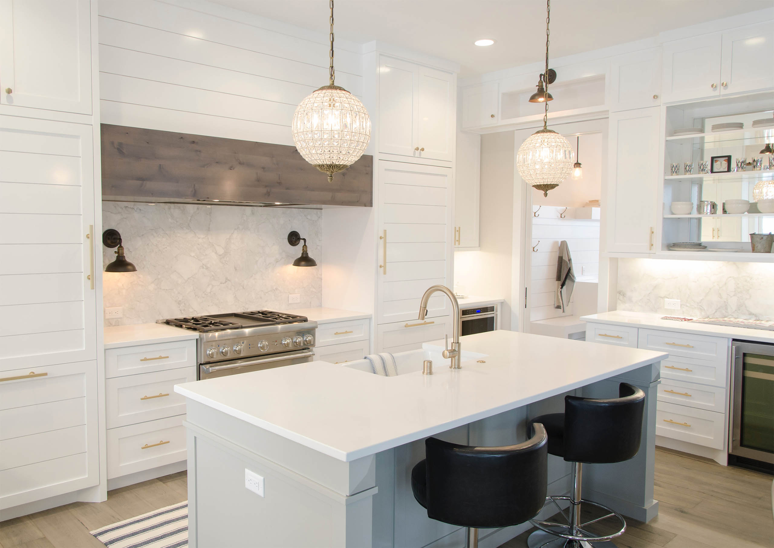 Luxury Kitchen with Marble Countertops and Globe Chandelier